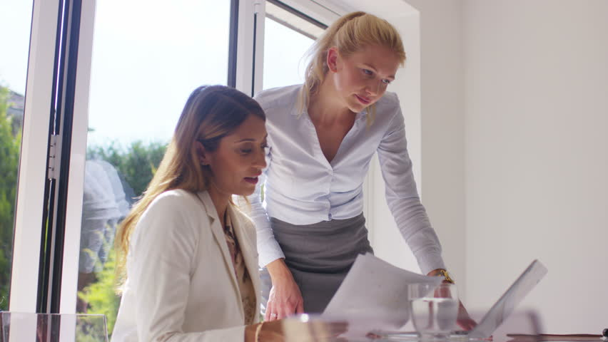 4K Attractive businesswomen working together in light modern office   Shutterstock HD Video #15216829
