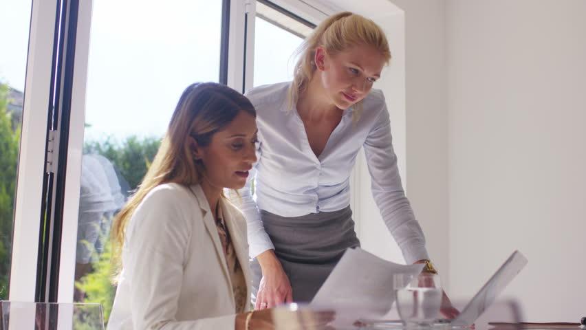 4K Attractive businesswomen working together in light modern office   Shutterstock HD Video #15216895