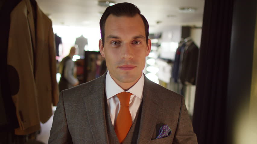 4K Handsome man trying on a new suit in tailor's shop | Shutterstock HD Video #15285940