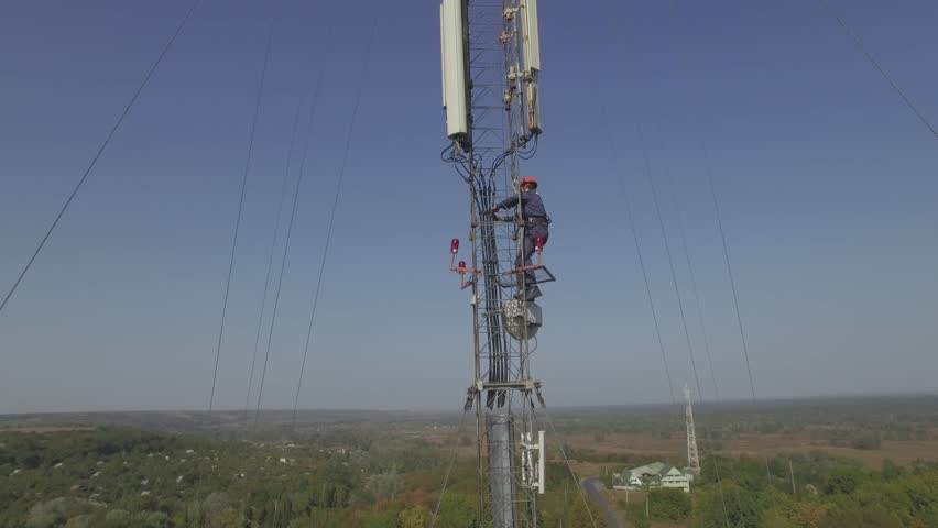 Drone Fly Top of the steel mobile tower used for GSM communication with the blue sky   Shutterstock HD Video #15314950