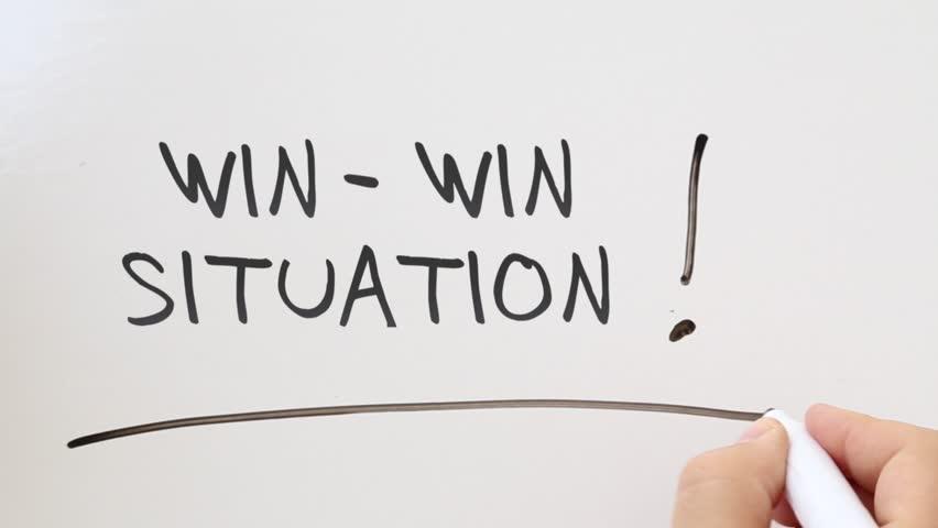 Shot of Win win written on whiteboard