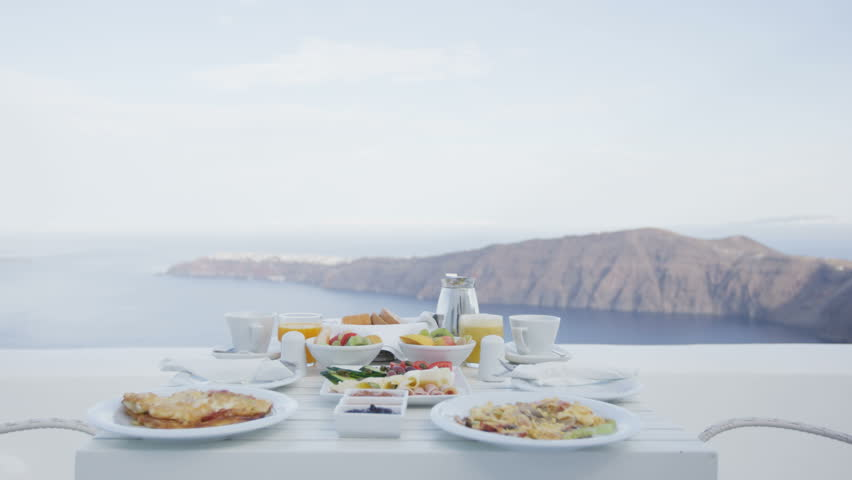 Breakfast Table Romantic By The Sea. Perfect Breakfast Table For Two  Outdoors. Amazing Caldera View On Santorini, Greece, Europe.
