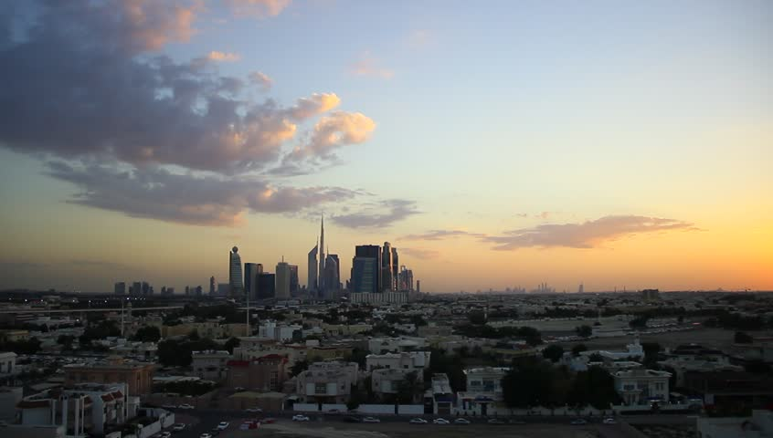 Afterglow to darkness sky time lapse. Light dark clouds over Dubai skyline. Aerial view, flat urban area ahead, pack of tall towers seen far afield, Dubai Downtown and skyscrapers around Sheikh Zayed | Shutterstock HD Video #15338230