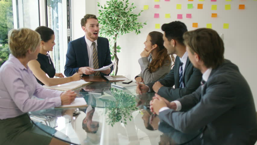 4K Corporate business group in a meeting looking over the company figures | Shutterstock HD Video #15350200