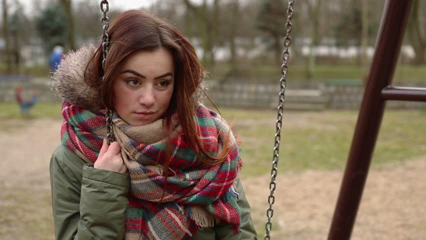 Sad beautiful young woman on a swing | Shutterstock HD Video #15366670