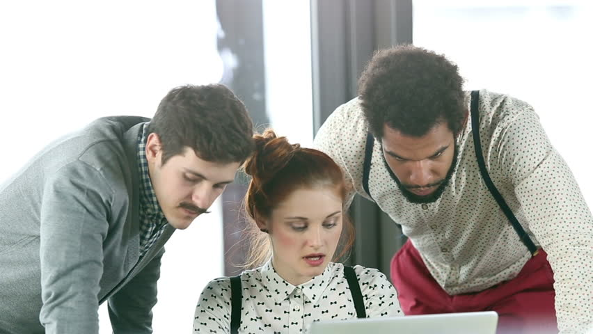 Close up of young creative team discussing plans in office meeting, slow motion, graded | Shutterstock HD Video #15413890