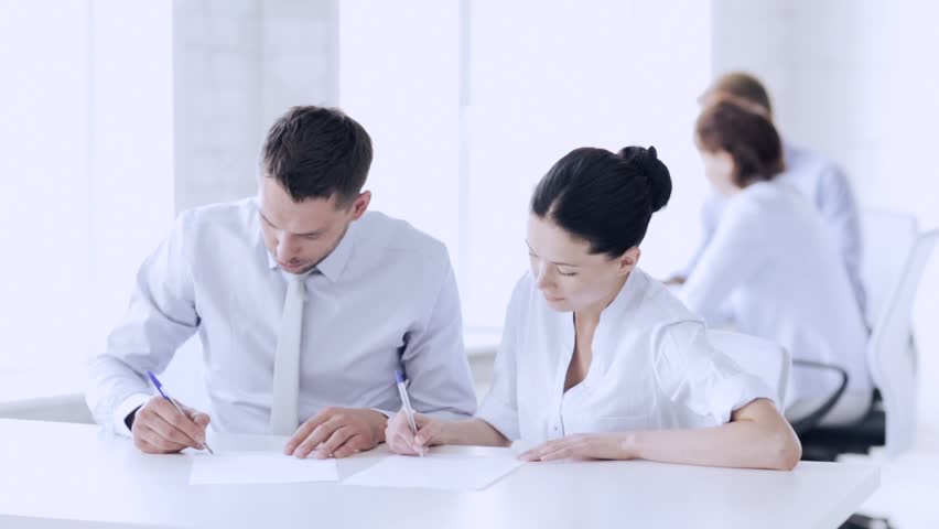 Business and office - man and woman signing a contract | Shutterstock HD Video #15422800