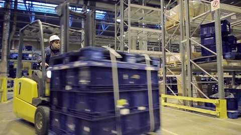 Loader operator working in warehouse