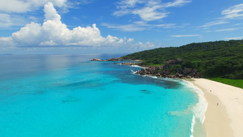 Aerial view of tropical paradise beach with white sand and turquoise crystal clear water of Indian Ocean - Grand Anse, La Digue Island, Seychelles, 4k UHD ProRes