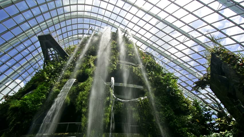 Singapore. Circa March 2016. Waterfall inside the Cloud Forest conservatory in Gardens by the Bay . Dutch angle