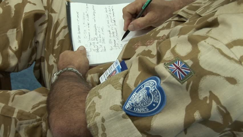 NICOSIA, CYPRUS - OCTOBER 24, 2005: British United Nations peacekeeper officer note-taking in UN meeting