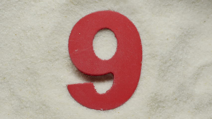 Nine. Wooden number in sand. For creation countdown. | Shutterstock HD Video #15506440