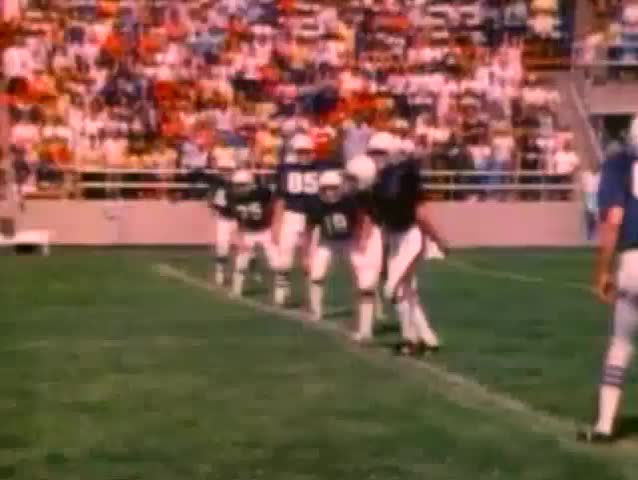 Kick off at high school football game, 1980s