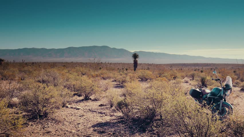 Traveler parked his motorcycle in the mexican desert. 4k  | Shutterstock HD Video #15543910