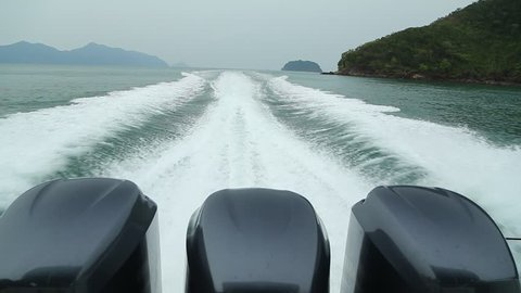 Rear view of motor speed boat on open sea at high speed