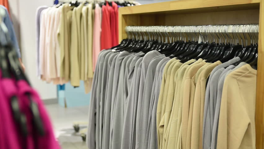 71cb727b6a Beautiful Woman Shopping in Clothing Stock Footage Video (100 ...