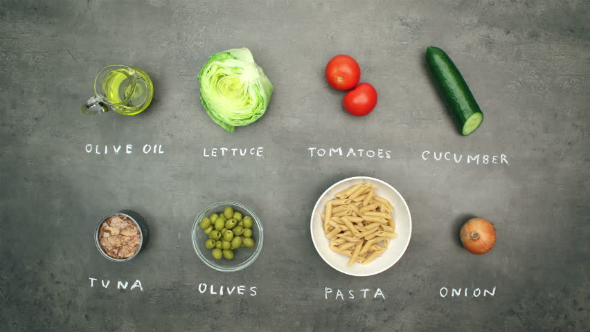 Tuna salad with pasta and vegetables. Top view on recipe ingredients and preparation on grey kitchen table. Stop motion animation and timelapse eating. #15571414