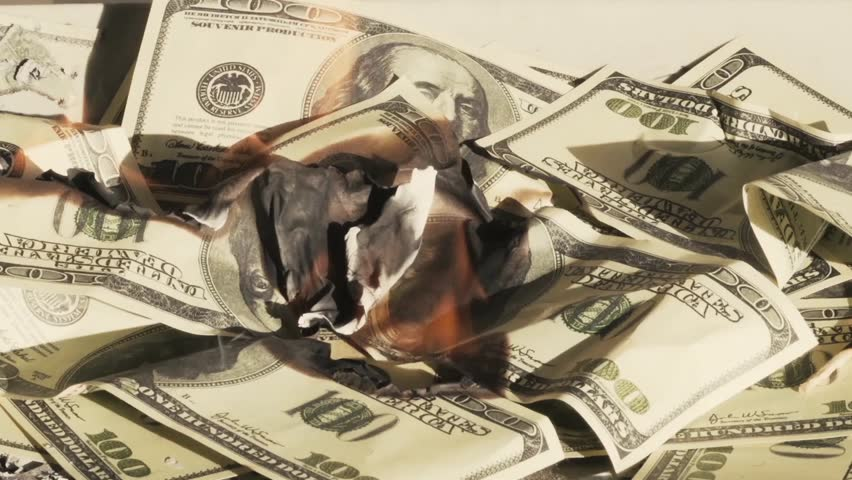 Burning Money (Debt, Taxes, Financial Cliff, Overspending) Quick time | Shutterstock HD Video #15581080