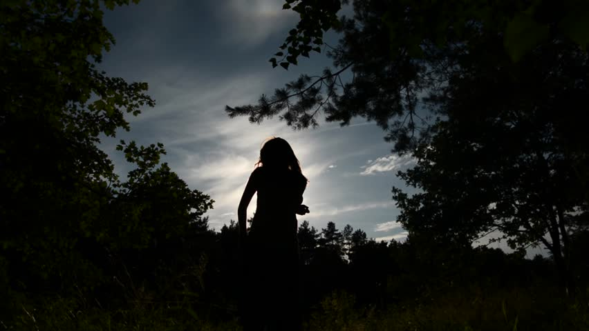 silhouette of a dancing girl opposite the Sun