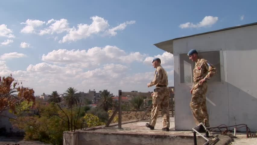 NICOSIA, CYPRUS - OCTOBER 24, 2005: United Nations British Army peacekeepers on Cyprus rooftop patrol
