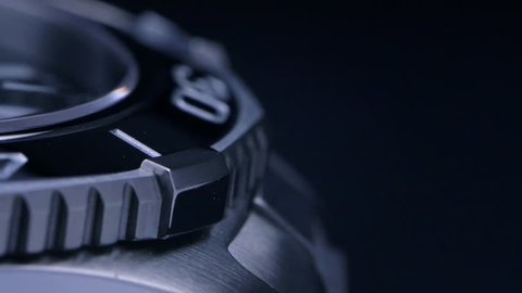 Beautiful abstract shot of a mechanical swiss watch / Slow rotation - macro shot on the steel and ceramic