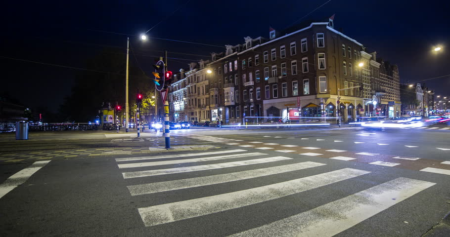 Amsterdam, Netherlands - Crossing with trams in downtown Amsterdam - Timelapse - 11/14 | Shutterstock HD Video #15642580