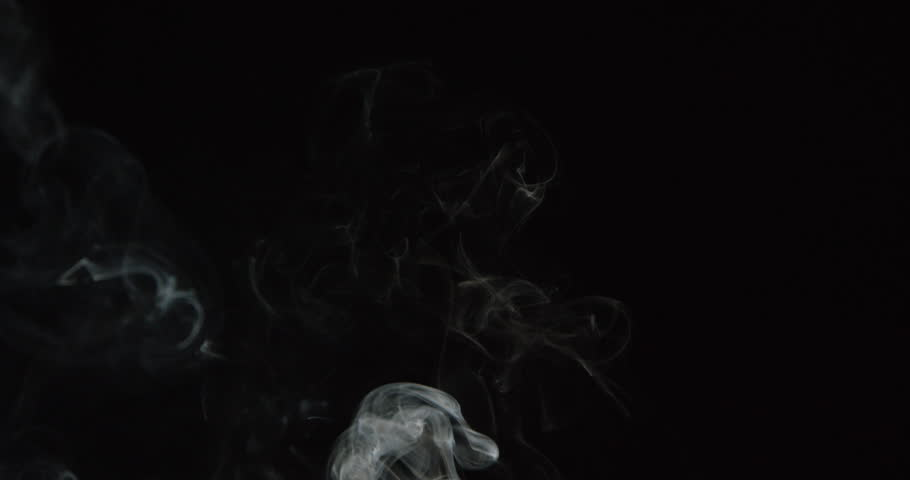 Wisps smoke billow and swirl in slow motion on black background, ALPHA MATTE for compositing