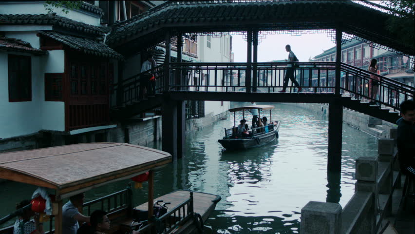 Shanghai Zhujiajiao water village FangSheng bridgeBridge over the canals in the water village of ZhuJiaJiao near Shanghai.   Shutterstock HD Video #15723874