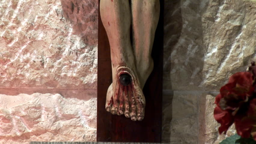 statue of the crucified Jesus in the grotto of Gethsemane