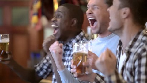 Happy man in a bar with beer