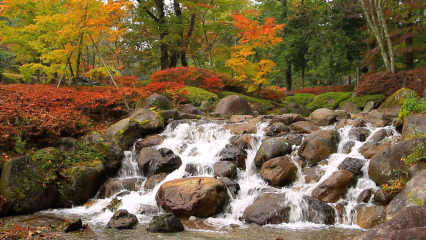 Mountain Stream with waterfall in Autumn.