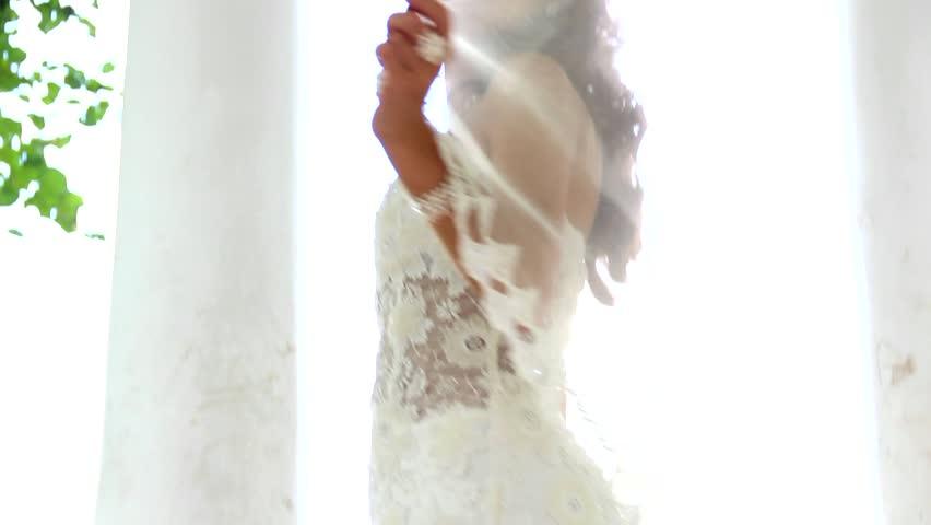 beautiful bride showing her wedding dress