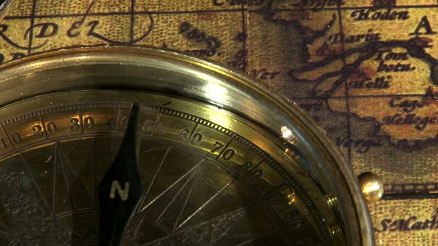 Golden compass and ancient map, zoom