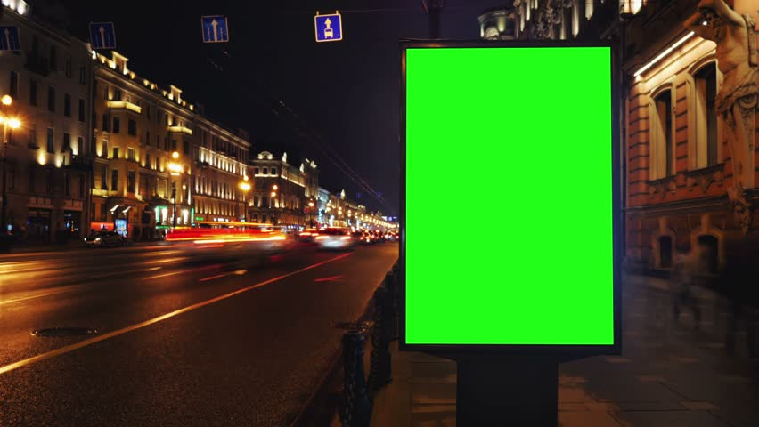 A Billboard with a Green Screen on a Busy Night Street.Time Lapse.   Shutterstock HD Video #15819574