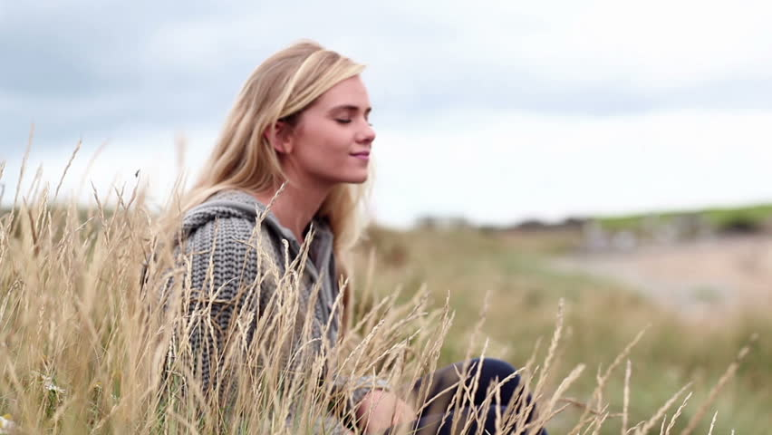 Blonde woman relaxing in the dunes in cinemagraph style | Shutterstock HD Video #15828517