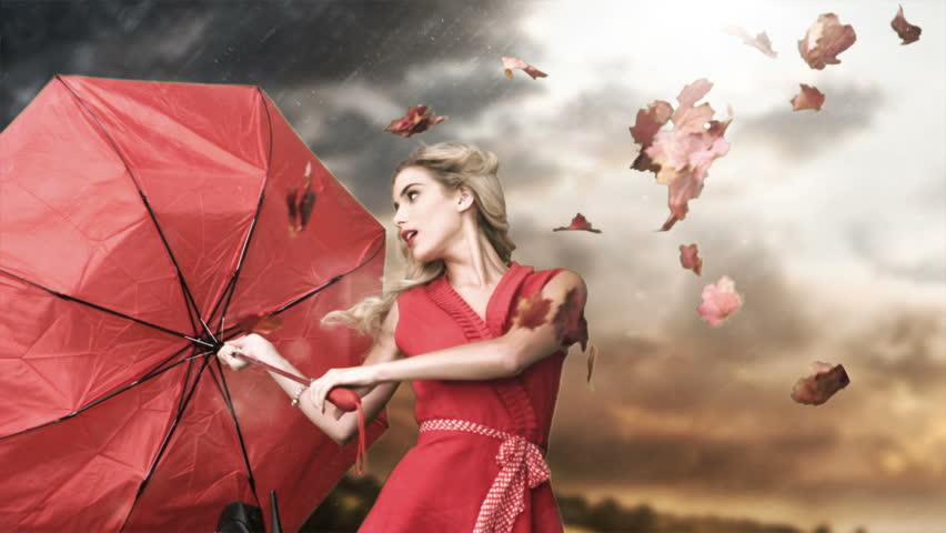 Glamour woman holding a broken umbrella in cinemagraph style