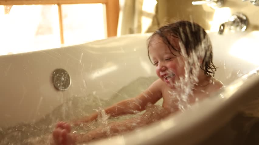 White 9 years old girl and 2 years old toddler boy playing while take a bath. Lamy, NM : February, 2016 | Shutterstock HD Video #15846172