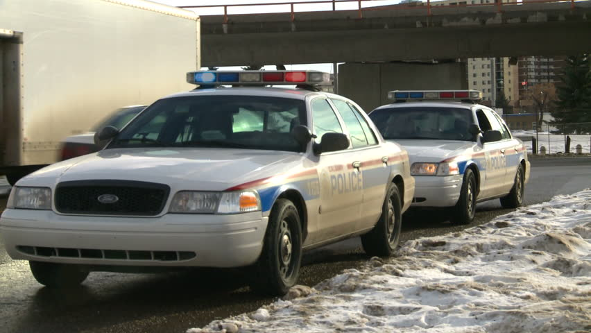 CALGARY CANADA - CIRCA 2009 Police cars parked on the street circa 2009 & Car Explosion Slow-mo. Stock Footage Video 16625026 | Shutterstock markmcfarlin.com
