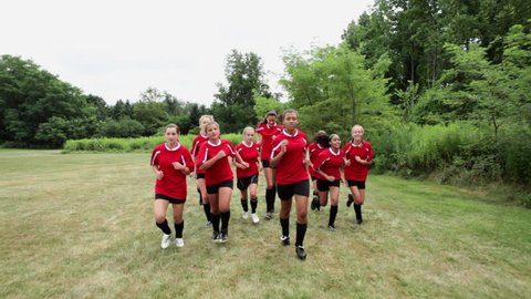 July 21, 2010: Girl soccer players running in field