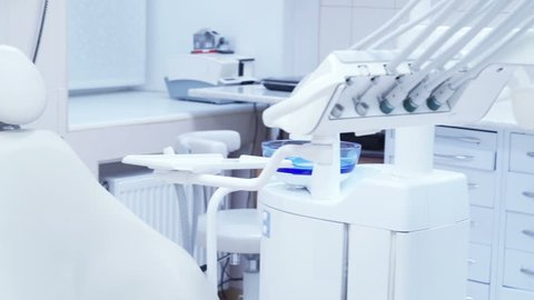 Dental clinic: room with dental chair and medical equipment
