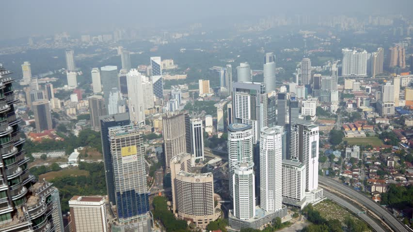 KUALA LUMPUR / MALASYA - AUGUST 23RD 2015: Asia Malaysia over head aerial Skyline Skyscrapers city busy metropolis business centre fiancial square tall buildings cityscape modern technology center | Shutterstock HD Video #15887380