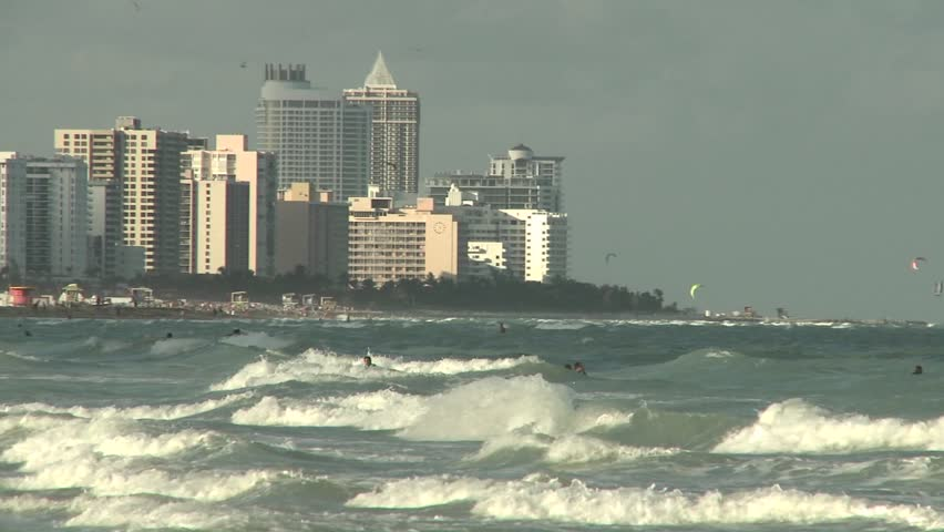 WS - Hotels along Miami Beach with rolling waves in foreground