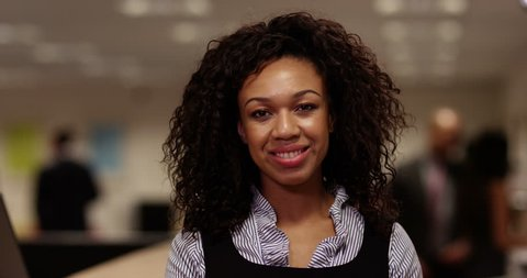 4k, An attractive African American young businesswoman nodding at the camera while having a video conference in her office.