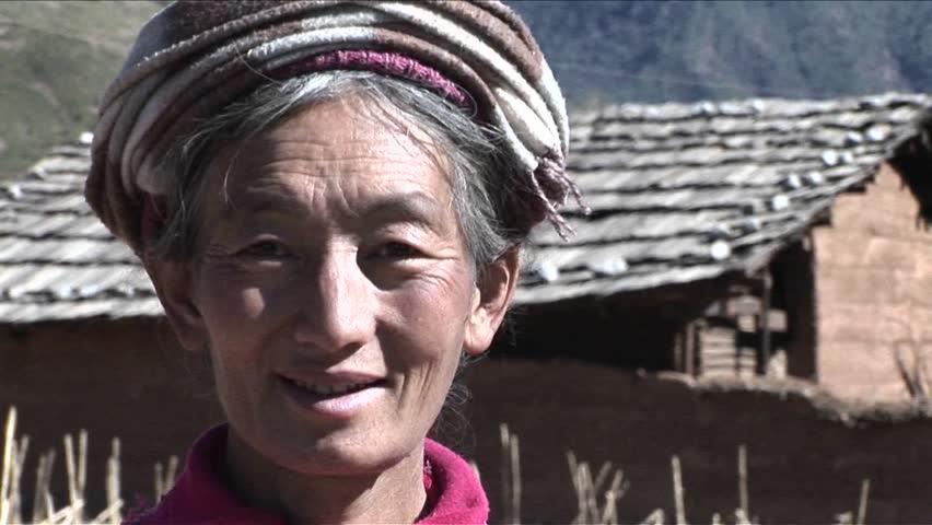 CHINA - CIRCA 2009: A tribal woman smiles at the camera, circa 2009 in China.