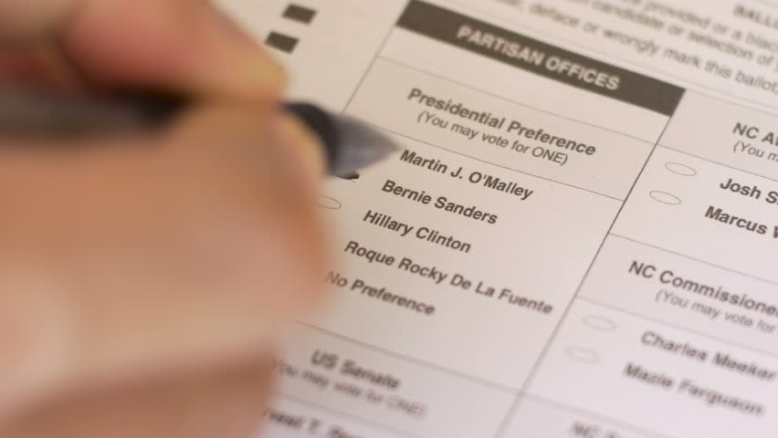 ASHEVILLE, NC. - UNITED STATES - CIRCA JANUARY 2016 - Close up of hand filling in voting ballot and circling a vote for Bernie Sanders in the 2016 primary election on an absentee or paper ballot in 4k