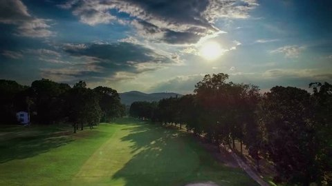 Aerial Fly over of golf course at sunset
