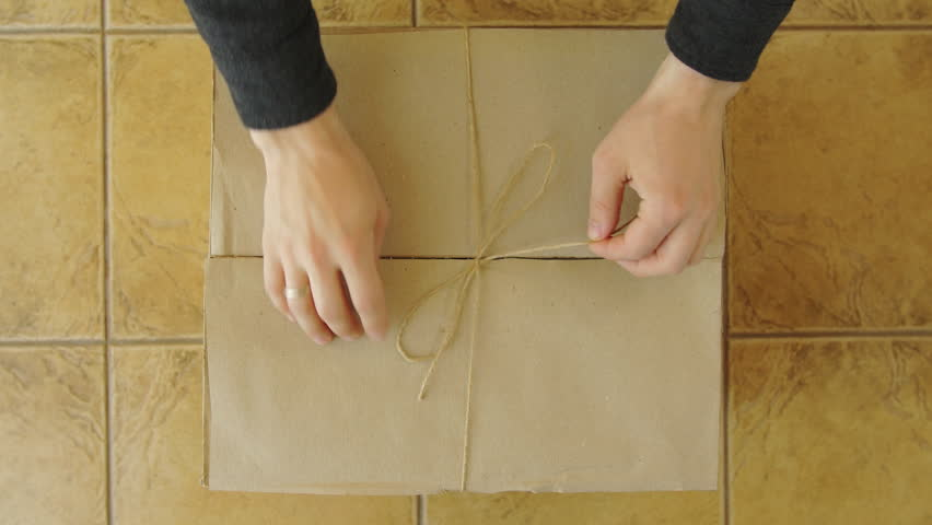 A young man hands opens a parcel contains a gift. Unpacking box with another box. Surprise. People, delivery, shipping service, opening cardboard box or parcel at home. | Shutterstock HD Video #16018894