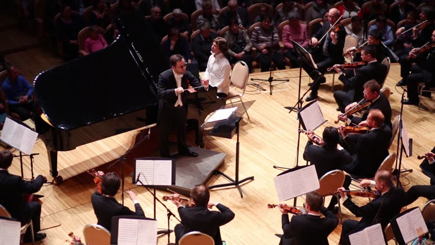 MOSCOW - APR 20, 2015: Conductor at concert devoted to 100th anniversary of David Ashkenazy in House of Music, Svetlanov hall
