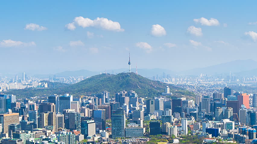 Time lapse of Cityscape in Seoul with Seoul tower and blue sky, South Korea.