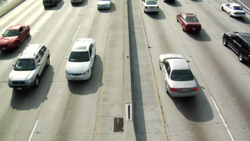 Traffic drives along a freeway